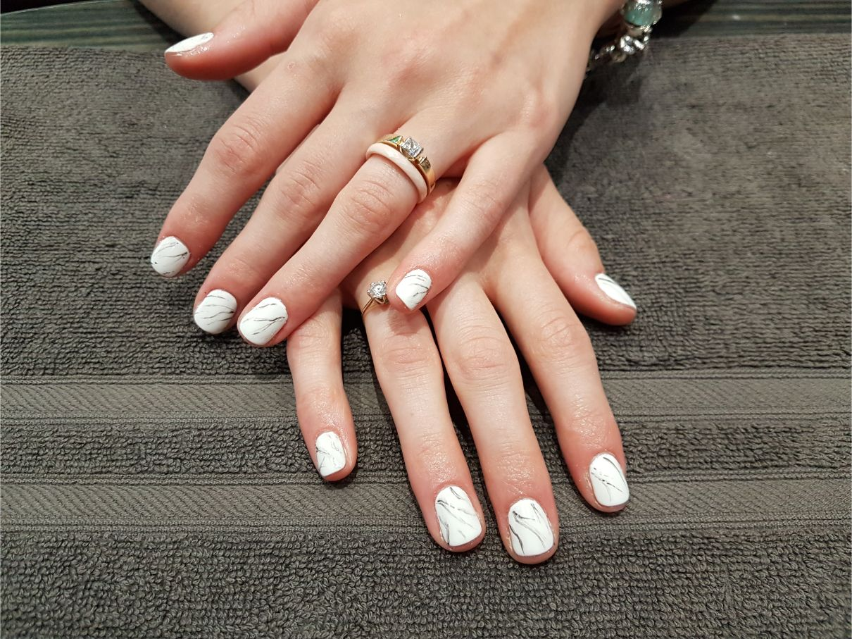 hands with white nail polish