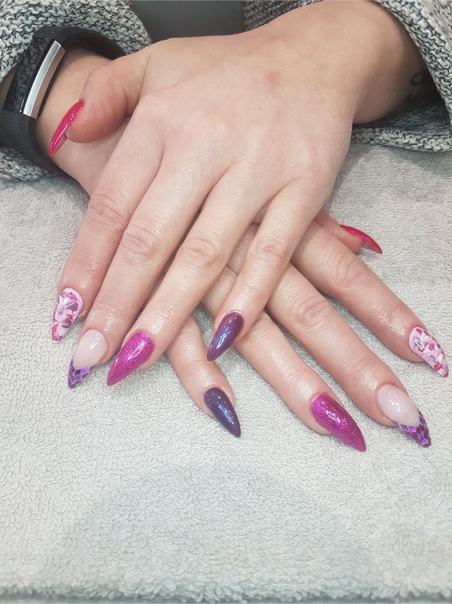 hands with shade of purple nail art