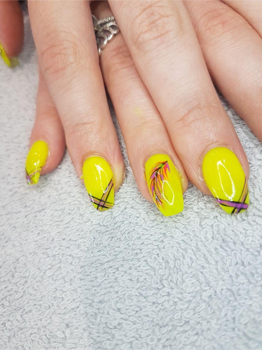 hands with yellow nail art