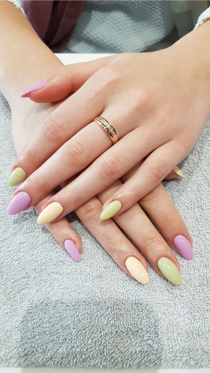 hands with yellow and purple nail polish