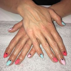 hands with red and green nail polish