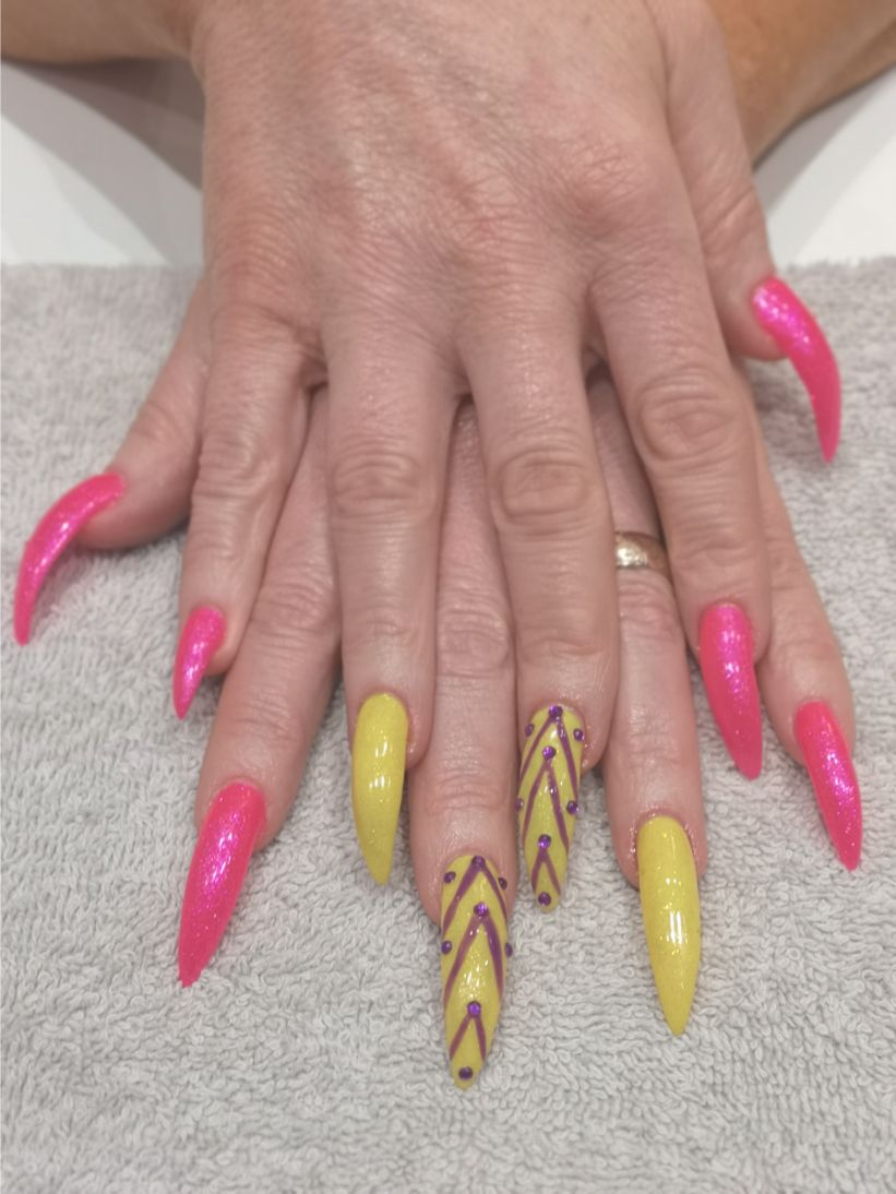 hands with pink and yellow fake nails