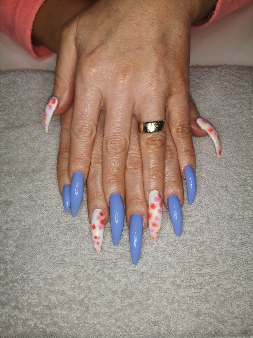 hands with blue and white fake nails