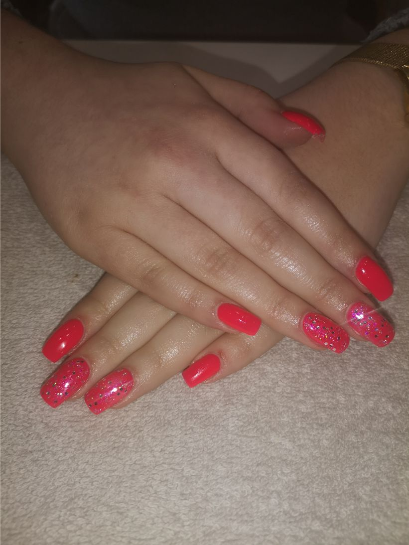hands with light red nail polish